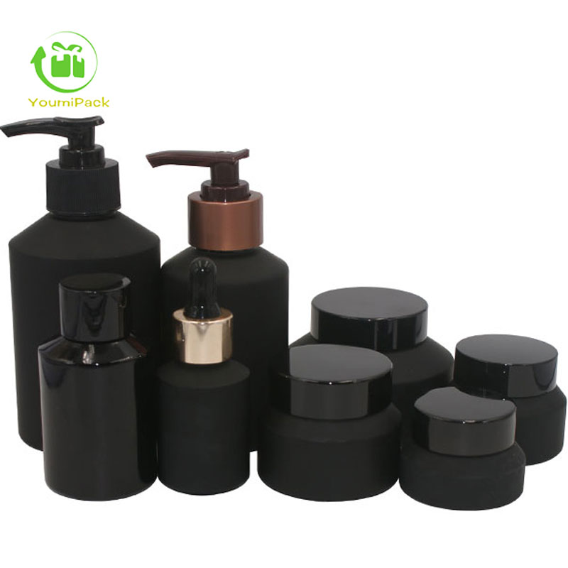 black glass bottles and jars set