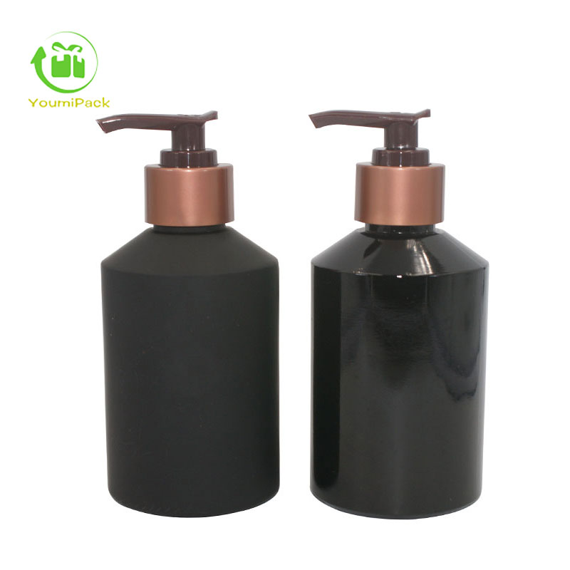 black glass bottles with rose bronze pump