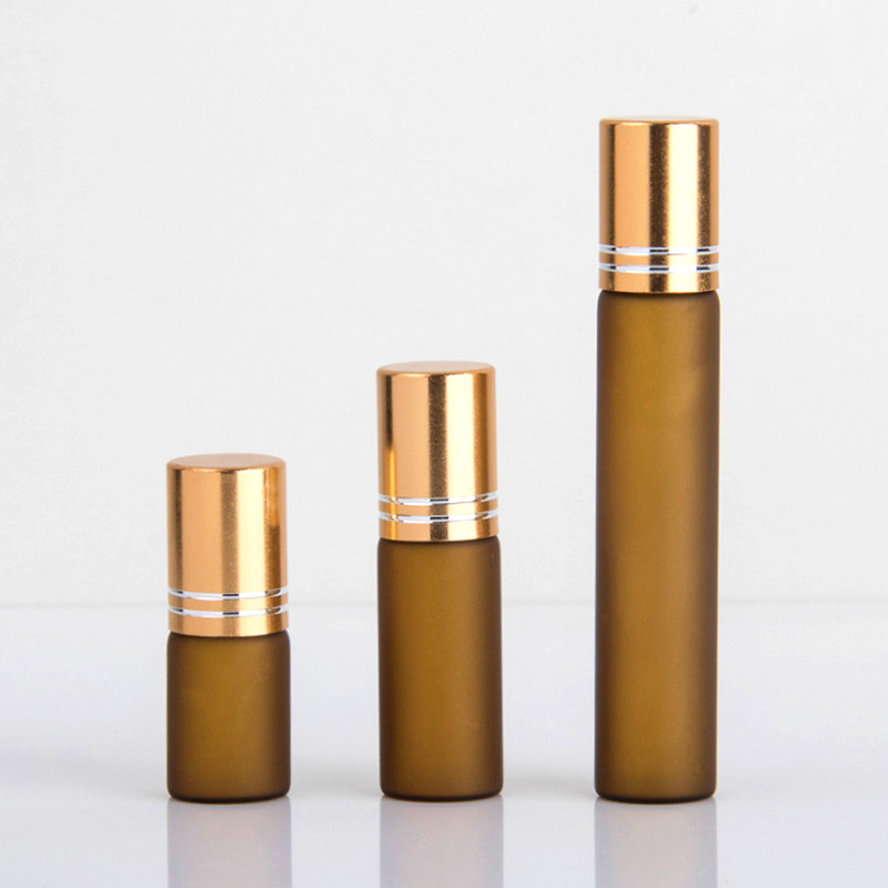 Amber frosted glass roll on bottles with gold cap