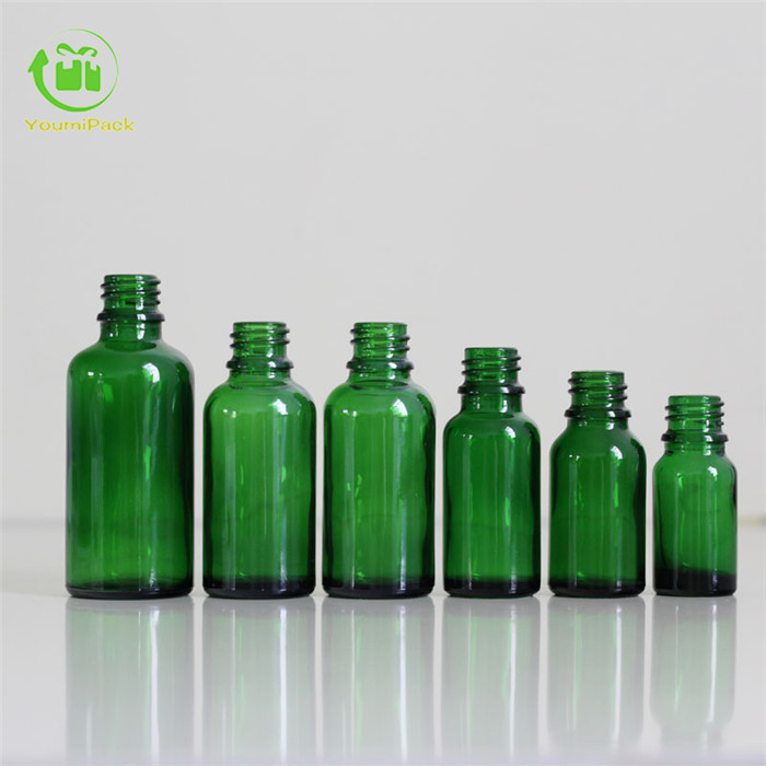 Green glass essential oil bottle